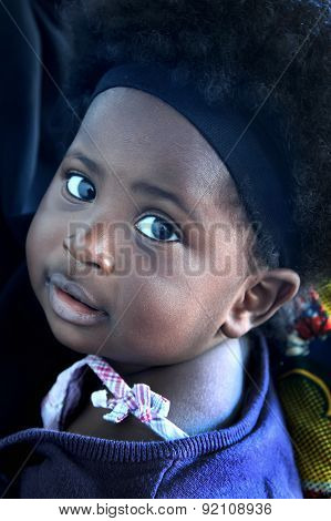 Accra, Ghana - July 1, 2014.  Unidentified Ghanaian Little Girl With Big Eyes. People Of Ghana Suffe