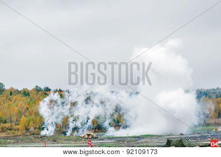Russian tank T-90 hides in smoke screen from enemy