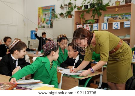 Ashgabad, Turkmenistan - November 4, 2014. Group Of Students With The Teacher  In Lesson.  November