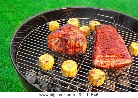 Barbecue Pork Eisbein And Spareribs On The Flaming Charcoal Grill