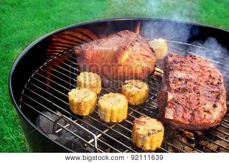 Barbecue Eisbein And Spareribs On The Flaming Charcoal Grill