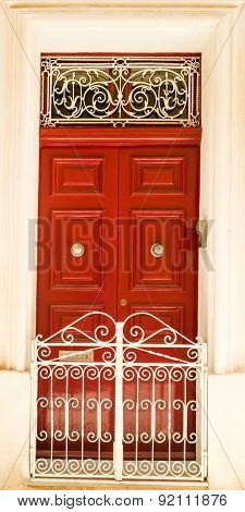 colourful red front door to house