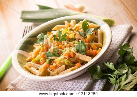 pasta with carrot leek and pine nuts, selective focus