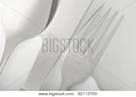 silverware fork, knife, spoon on white table