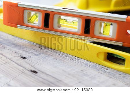 Red And Yellow Building Level On The Wood Table