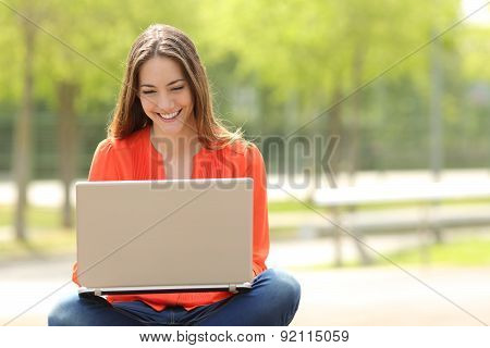 Student Girl Working With A Laptop In A Green Park