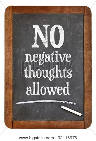 No negative thoughts allowed - motivational and positive text on a vintage slate blackboard