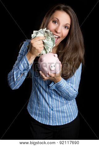 Money woman holding piggy bank