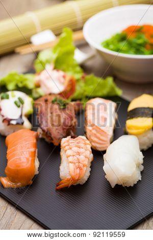 Sushi Assortment On Black Dish, Close Up