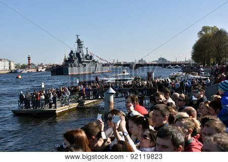 ST. PETERSBURG, RUSSIA - MAY 9, 2015: Thousands of people watch the naval parade dedicated to the Victory Day. This is the first naval parade included in the Victory Day celebrations in St. Petersburg