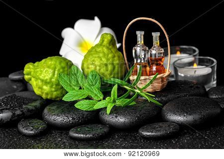 Aromatic Spa Of Bottles Essential Oil In Basket, Fresh Mint, Rosemary, Bergamot Fruits, Flower And C