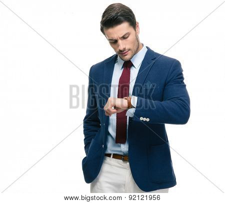 Confident businessman looking on his wrist watch isolated on a white background