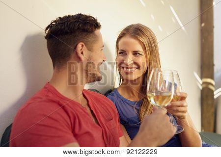 Couple Enjoying Wine In Their Backyard