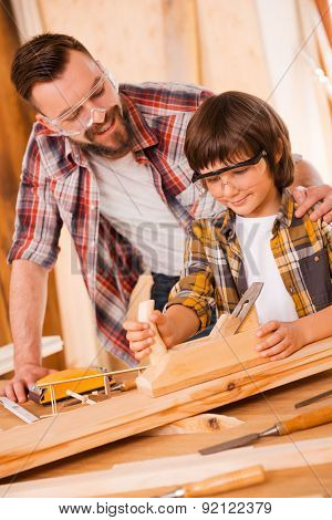 Teaching His Son All About Carpentry.