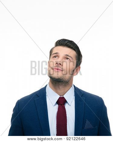 Pensive businessman looking up at copyspace isolated on a white background
