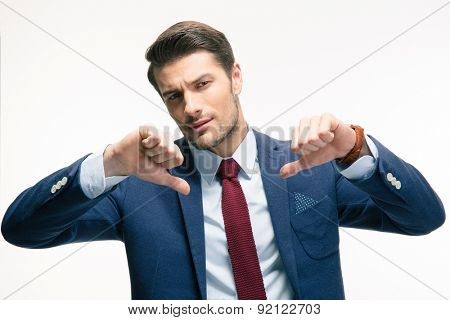 Confident businessman showing thumbs down sign isolated on a white background. Looking at camera