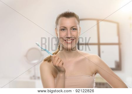 Smiling Healthy Woman Holding A Toothbrush