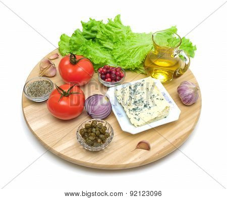 Different Foods On A Cutting Board On A White Background