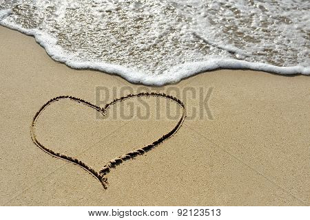 Love Concept - One Heart Drawn On Sand Beach