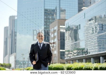Businessman Walking In A Business Center