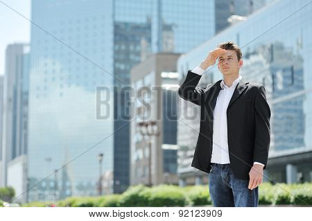 Young Businessman, On Background Modern Office Buildings