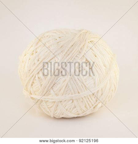 Natural Textured Two White Single Sheep Wool Roll or Ball or Tangle Closeup On Rustic Wood Table or