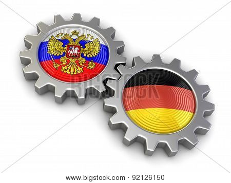 Russian and German flags on a gears (clipping path included)