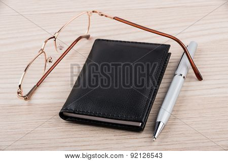 Notepad, Pen And Glasses On Table