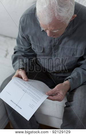 Old Man Worrying About Money