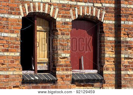Boarded Up Windows In An Old Brick Wall