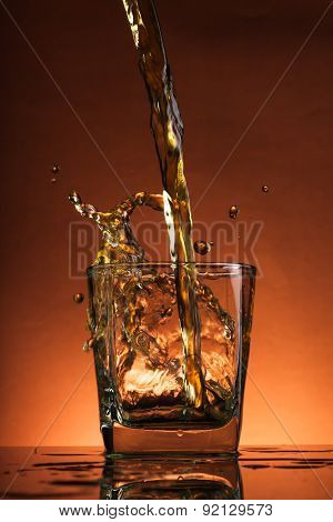 whiskey is poured into the glass