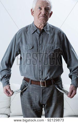 Elderly Man With Empty Pockets