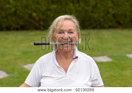 Senior Serene Woman Biting On A File