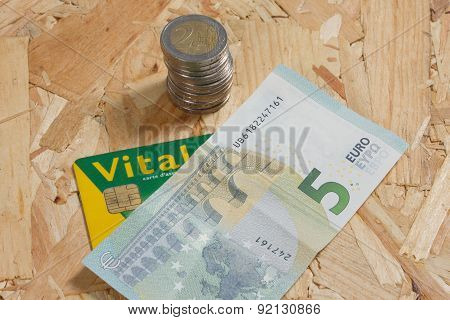 Concept Of Expensive Healthcare With Coins,notes And French Health Card