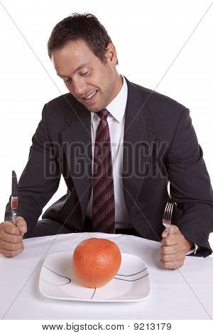 Man With Orange On Plate