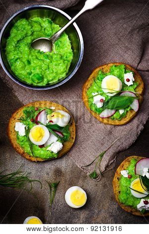 Canape With Green Peas Paste And Eggs