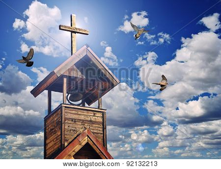 A Bell Tower With Cross, Heavenly Light And Doves