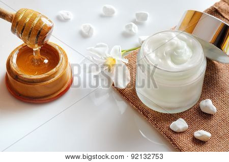 Honey Moisturizer With Stones And Flower Top View