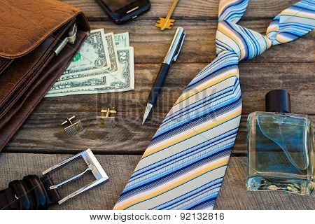 Men accessories: eau, cufflinks, dollars, strap, pen, mobile phone, document bag and key
