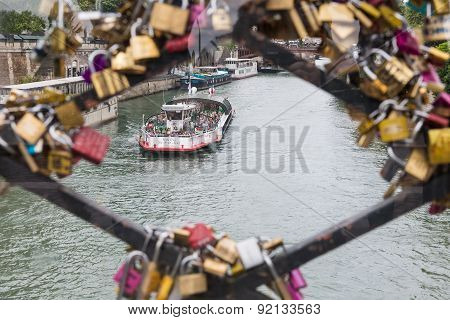 Cruise Ship Seen Through Love Padlocks Of Bridge In Paris