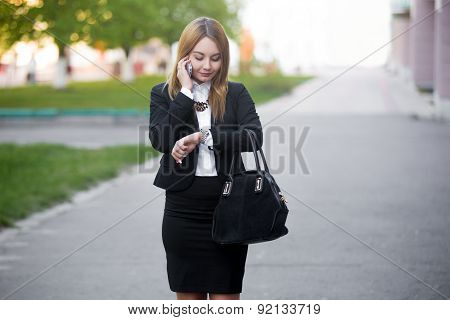 Young Business Woman Checking Time On Wristwatch
