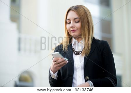 Young Business Woman Using Smartphone