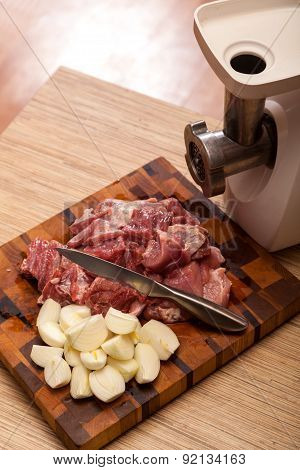 The Electric Meat Grinder And The Cut Meat