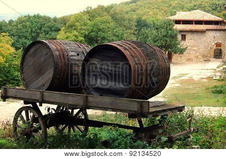 Two wooden fire barrels in a cart.