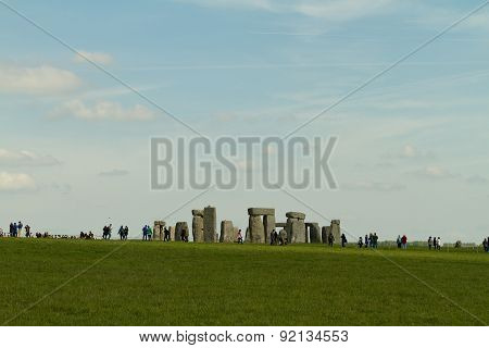 Amesbury, England - Circa May 2014: A View Towards The Stonehenge With People Walking Around Taken F