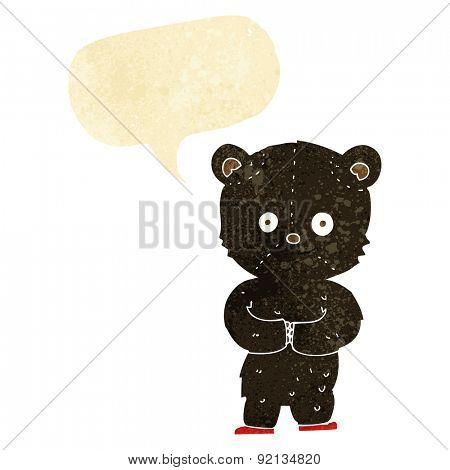 cartoon teddy black bear cub with speech bubble