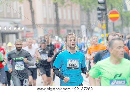 Large Group Of Male Runner In The Rainy Stockholm
