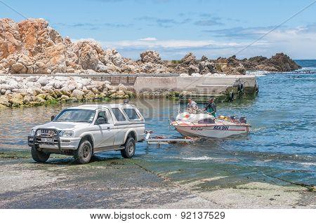 Crayfish Boat Being Pulled Onto Trailer At Kleinmond Harbor.