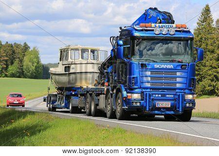 Scania 124 Truck Hauls A Boat