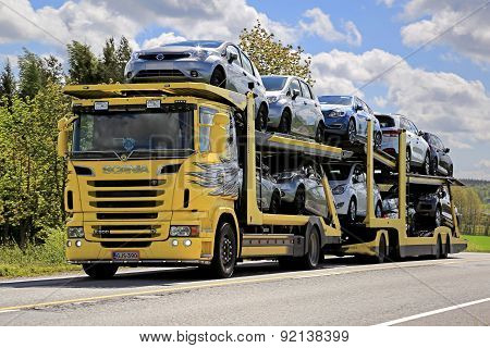 Yellow Scania R500 Car Carrier Hauls New Cars